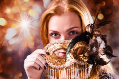 Woman with gold venetian mask Stock Photos