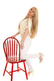 Woman gold zebra shirt kneel chair Stock Photos