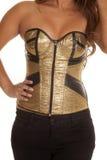 Woman gold zip up corset Royalty Free Stock Photos