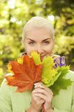 Woman with golden autumn leaves Royalty Free Stock Photos