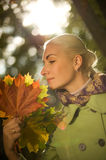 Woman with golden autumn leaves Stock Photos