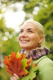Woman with golden autumn leaves Royalty Free Stock Photo