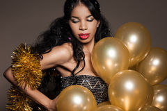 Woman with golden balloons. Woman with many golden balloons Stock Photography