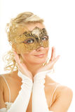 Woman in a golden carnival mask Stock Photo