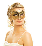 Woman in a golden carnival mask. Beautiful blond woman in a golden carnival mask Stock Image