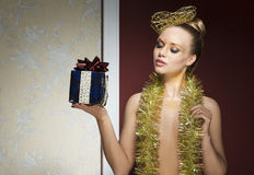 Woman with golden christmas style Royalty Free Stock Images