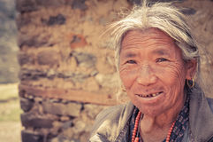 Woman with golden earrings in Nepal Stock Photography