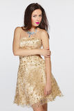 Woman in golden evening dress Stock Image