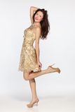 Woman in golden evening dress Royalty Free Stock Photos
