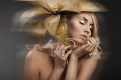 Woman with golden flower Royalty Free Stock Photography