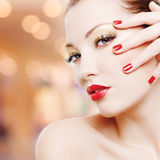 Woman with golden glamour makeup and red manicure Royalty Free Stock Images