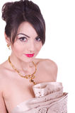 Woman with golden jewelry Stock Photography