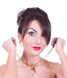 Woman with golden jewelry Stock Image