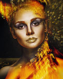 Woman with golden make-up Royalty Free Stock Photography