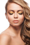 Woman with golden makeup Stock Photo