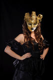Woman in golden mask Stock Photos