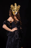 Woman in golden mask Stock Images