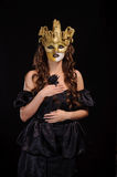 Woman in golden mask Royalty Free Stock Photography