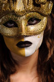 Woman in golden mask Royalty Free Stock Photos