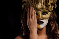 Woman in golden mask Stock Photography