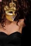 Woman in golden mask Royalty Free Stock Photo