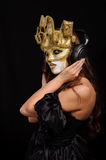Woman in golden mask Stock Photo