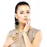 Woman with golden nails and beautiful gold jewelry Stock Images