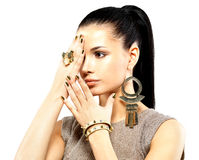 Woman with golden nails and beautiful gold jewelry stock photos