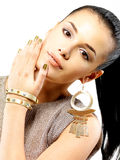 Woman with golden nails and beautiful gold jewelry Stock Photography