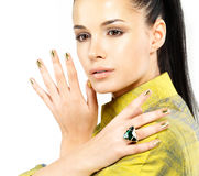 Woman with golden nails and precious stone emerald. Pretty woman with golden nails and beautiful precious stone emerald - isolated on white background royalty free stock images