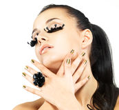 Woman with golden nails and style makeup stock images