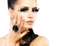 Woman with golden nails and style makeup Stock Image