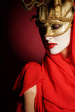 Woman in golden party mask Stock Photo