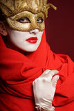 Woman in golden party mask Stock Images