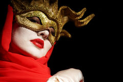 Woman in golden party mask Royalty Free Stock Image