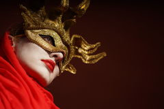 Woman in golden party mask Stock Photography