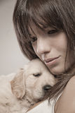 Woman with a golden retriever Royalty Free Stock Photo