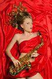 Woman with golden saxophone Royalty Free Stock Images