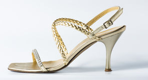 Woman golden shoes on white. Background Royalty Free Stock Photos