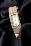 Woman golden watch with crystals Royalty Free Stock Photography