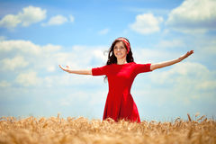 Woman in golden wheat Royalty Free Stock Photos