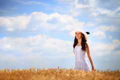 Woman in golden wheat field Stock Image