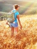 Woman in golden wheat field Stock Photos