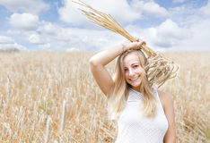 Woman in golden wheat field Stock Images
