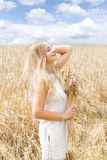 Woman in golden wheat field Royalty Free Stock Photography