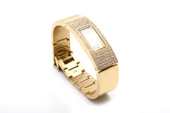 Woman golden wrist watch Royalty Free Stock Photos