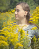 Woman by Goldenrod Stock Photo