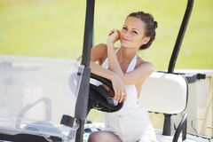 Woman in golf car Royalty Free Stock Photo