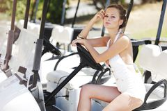 Woman in golf car Stock Photos