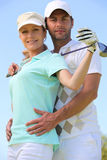 Woman with a golf club Royalty Free Stock Photography